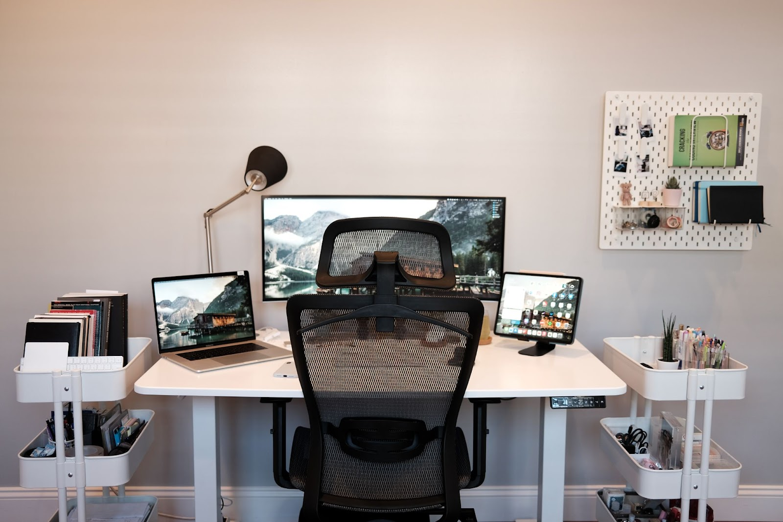 books, laptop, lamp, devices, and chair, in a workstation for animators