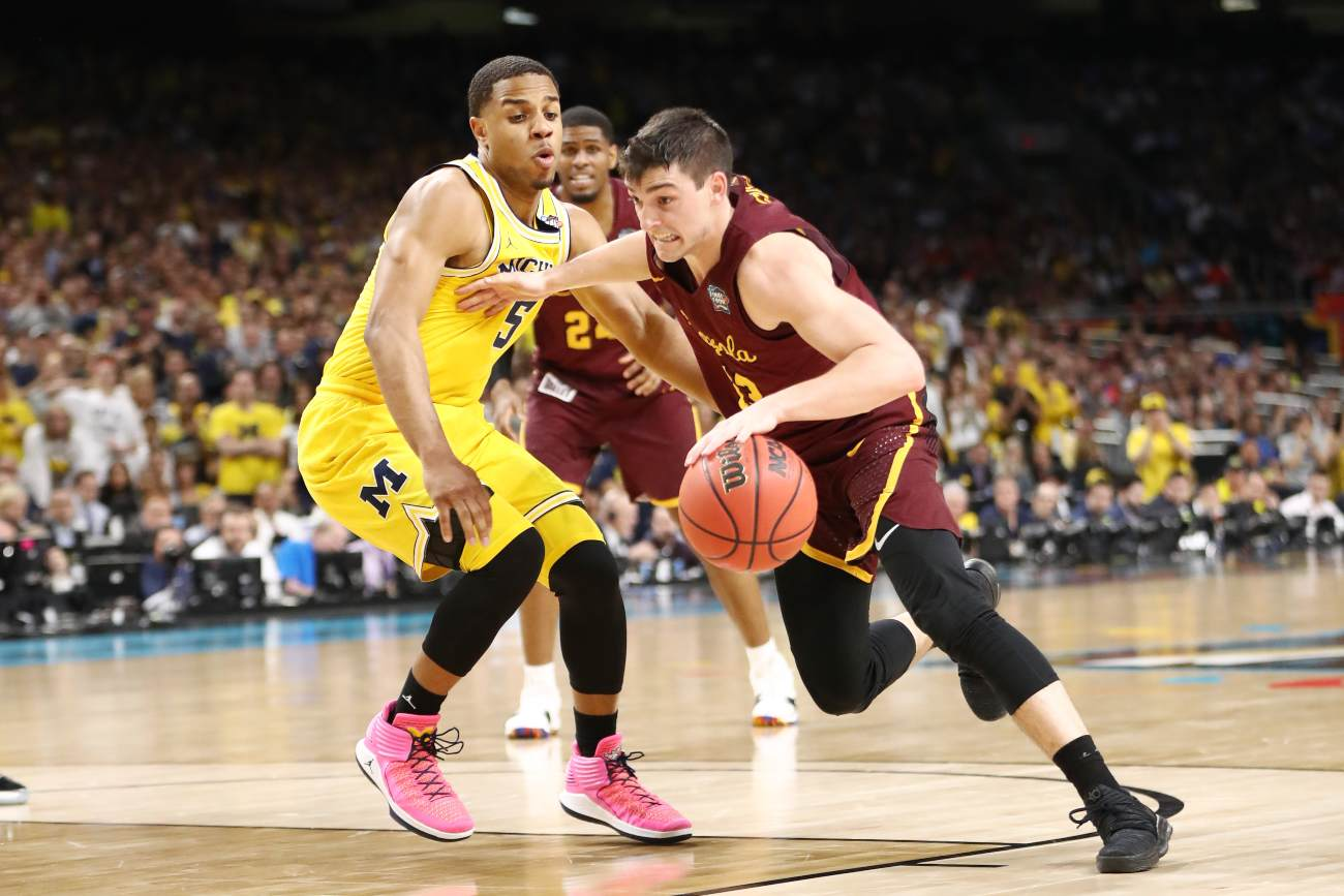Clayton Custer #13 of the Loyola Ramblers is defended by Jaaron Simmons #5 of the Michigan Wolverines in the second half during the 2018 NCAA Men's Final Four Semifinal at the Alamodome on March 31, 2018 in San Antonio, Texas. (Photo by Ronald Martinez/Getty Images)