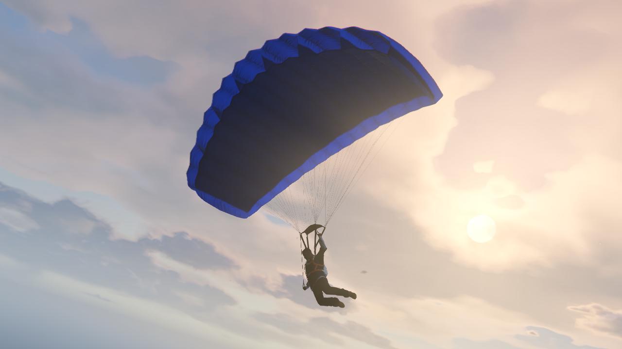 Fallschirmflug mit blauem Fallschirm