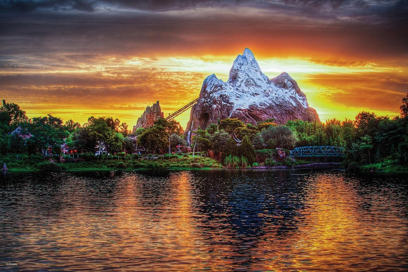 beautiful mountain with rides and attractions around it at Disney