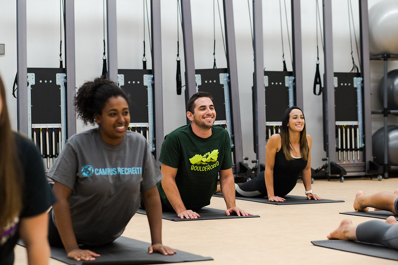students performing yoga in a Group Fitness class