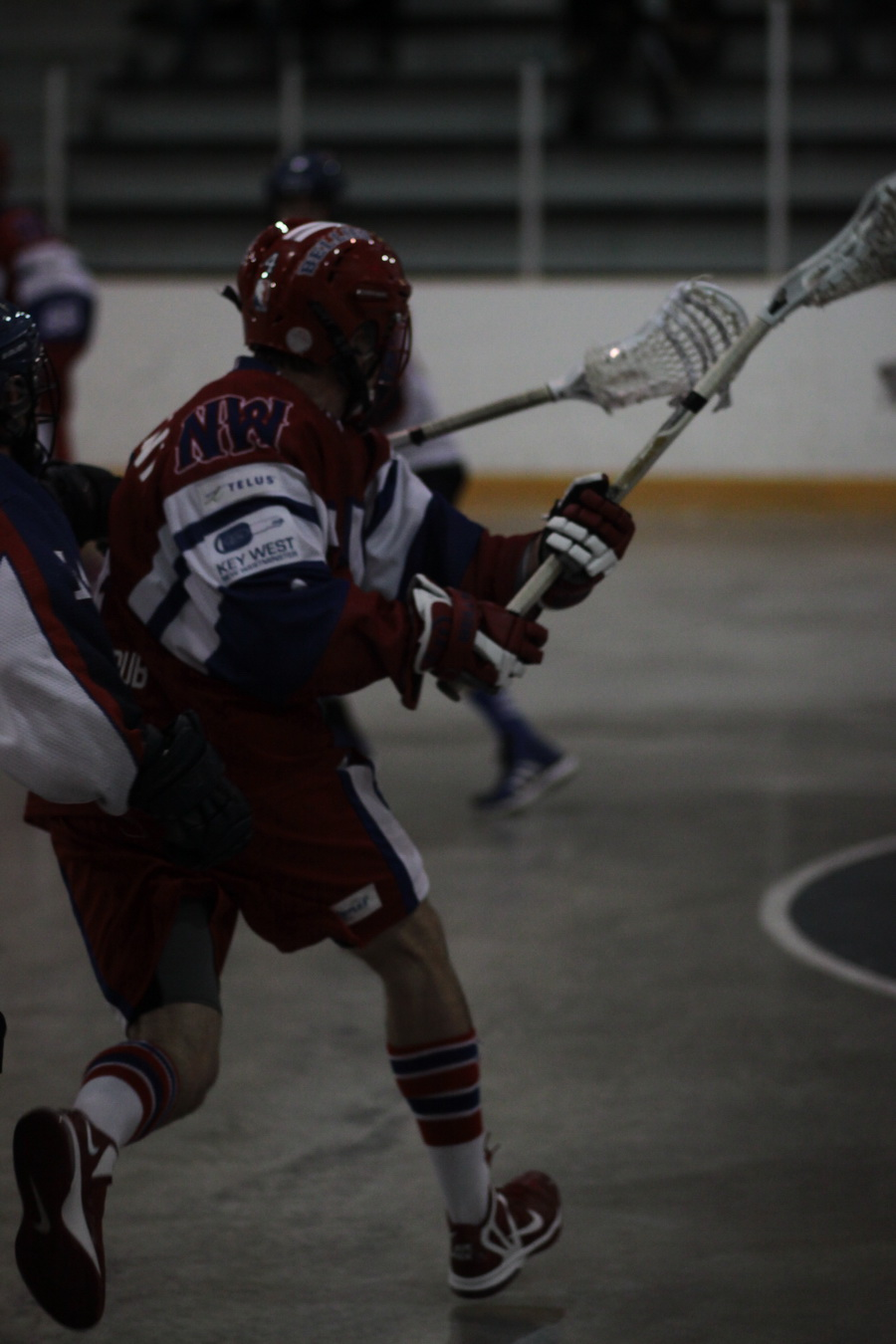 Chet Koneczny pro lacrosse player performing a face-dodge, showing good ball protection using a dodge technique