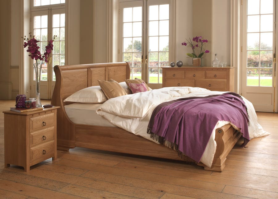 The Monaco Sleigh Bed in Natural Oak