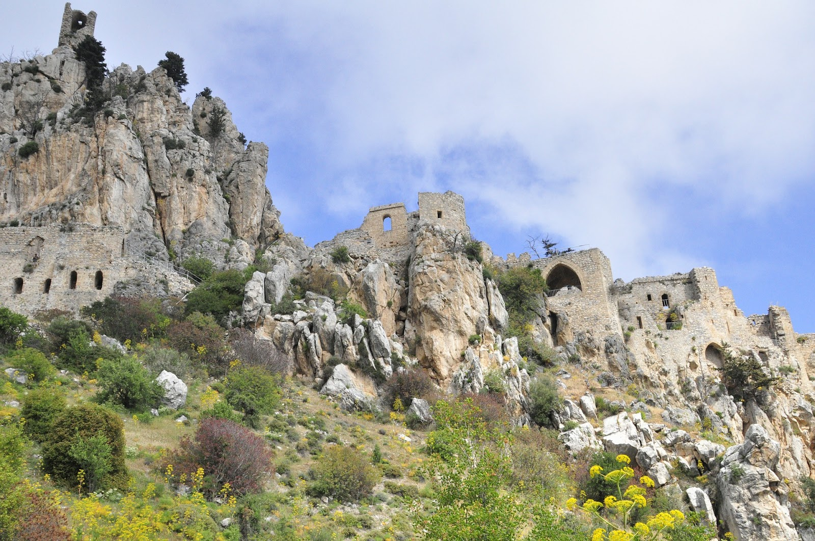 st hilarion castle on top of large cliff mountain in northern cyprus. the ruins can be accessed from a small mountain road. cloudy day in cyprus