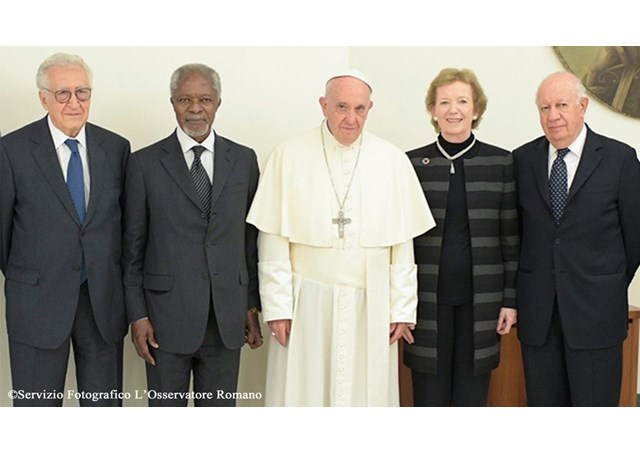 Mary Robinson stands beside Pope Francis with other members of The Elders during an audience at the Casa Santa Marta on Monday - RV