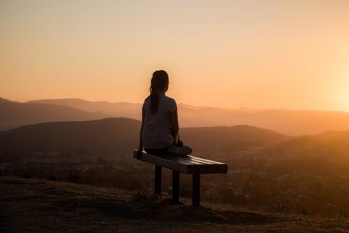 Girl sitting on desk in the morning