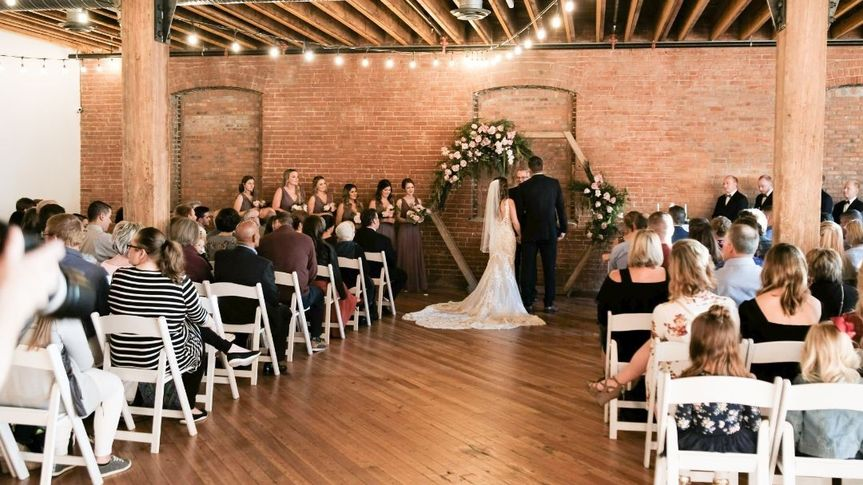 venue space with brick wall and people in chairs