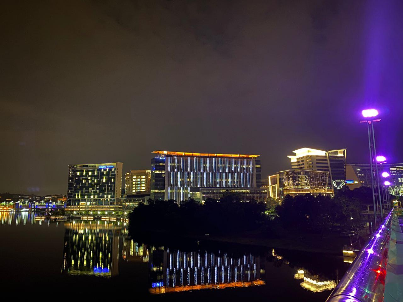 A picture containing water, city, nightDescription automatically generated