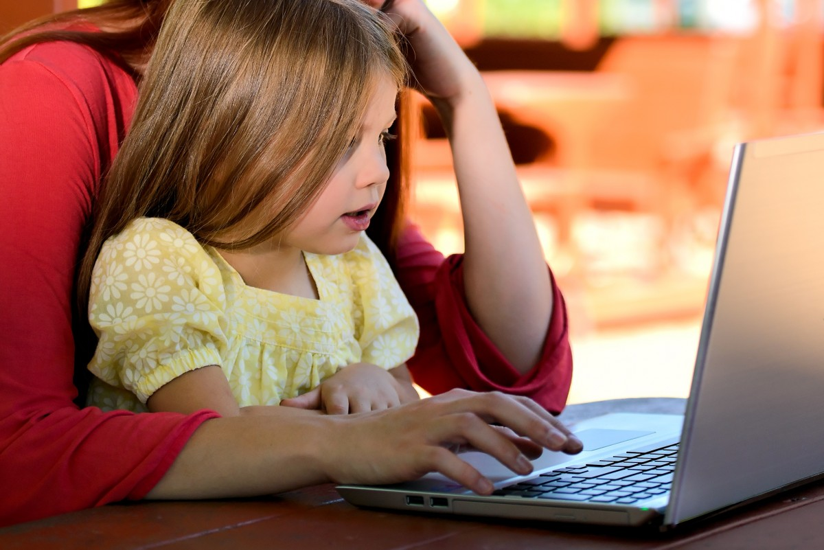 computer writing person girl woman reading love young sitting child childhood parent conversation caucasian family children mother learning daughter homework interaction mom and child mother daughter human positions human action mom and daughter