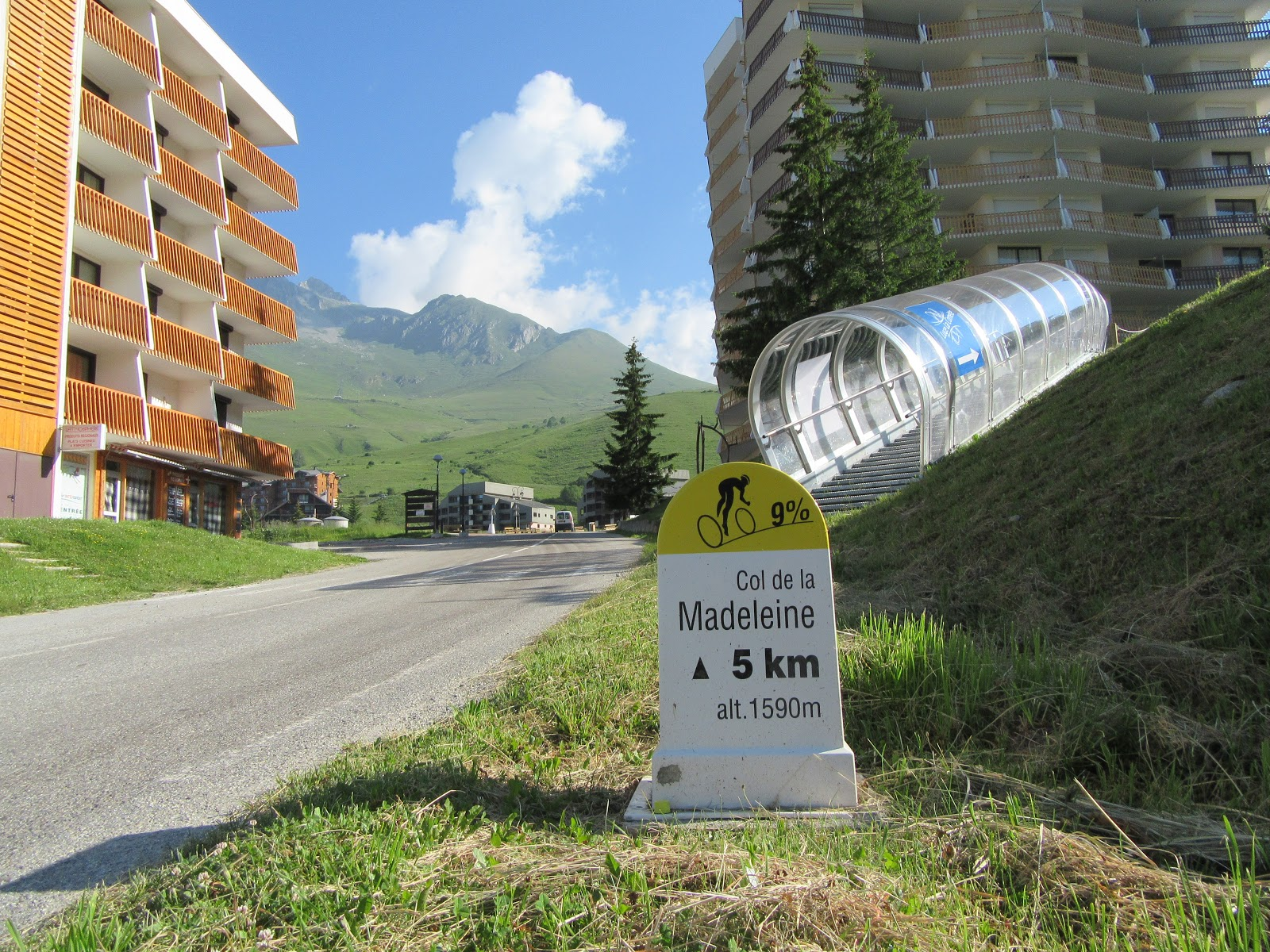 Bicycle ride of Col de Madeleine from La Chambre  - ski resort Longchamp with road, mountain and kilometer marker