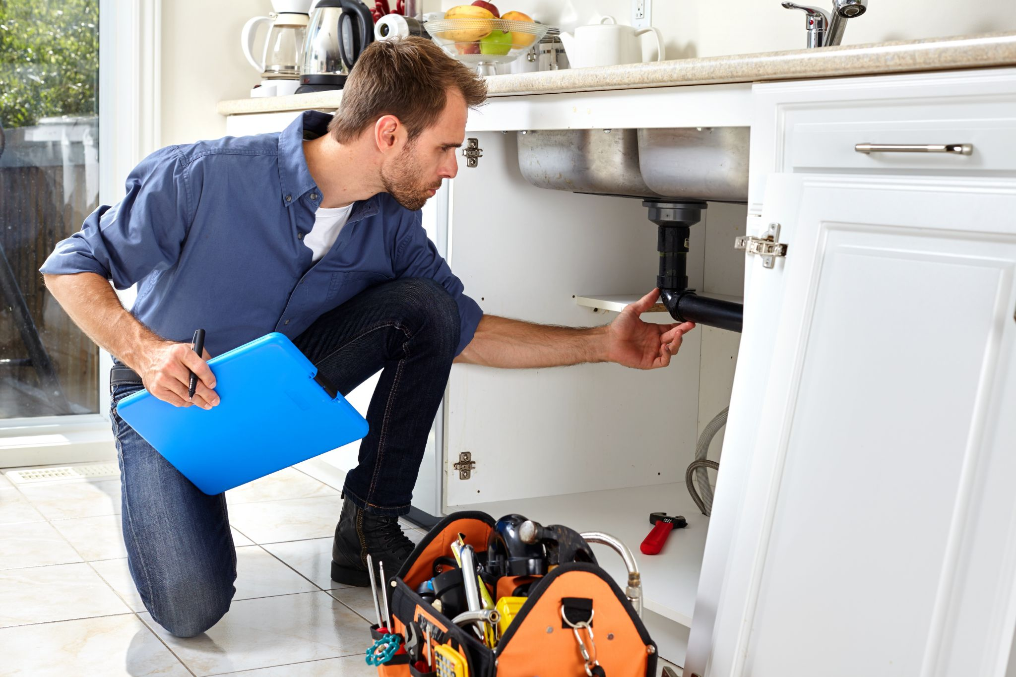 Structural engineer inspects plumbing during home inspection.