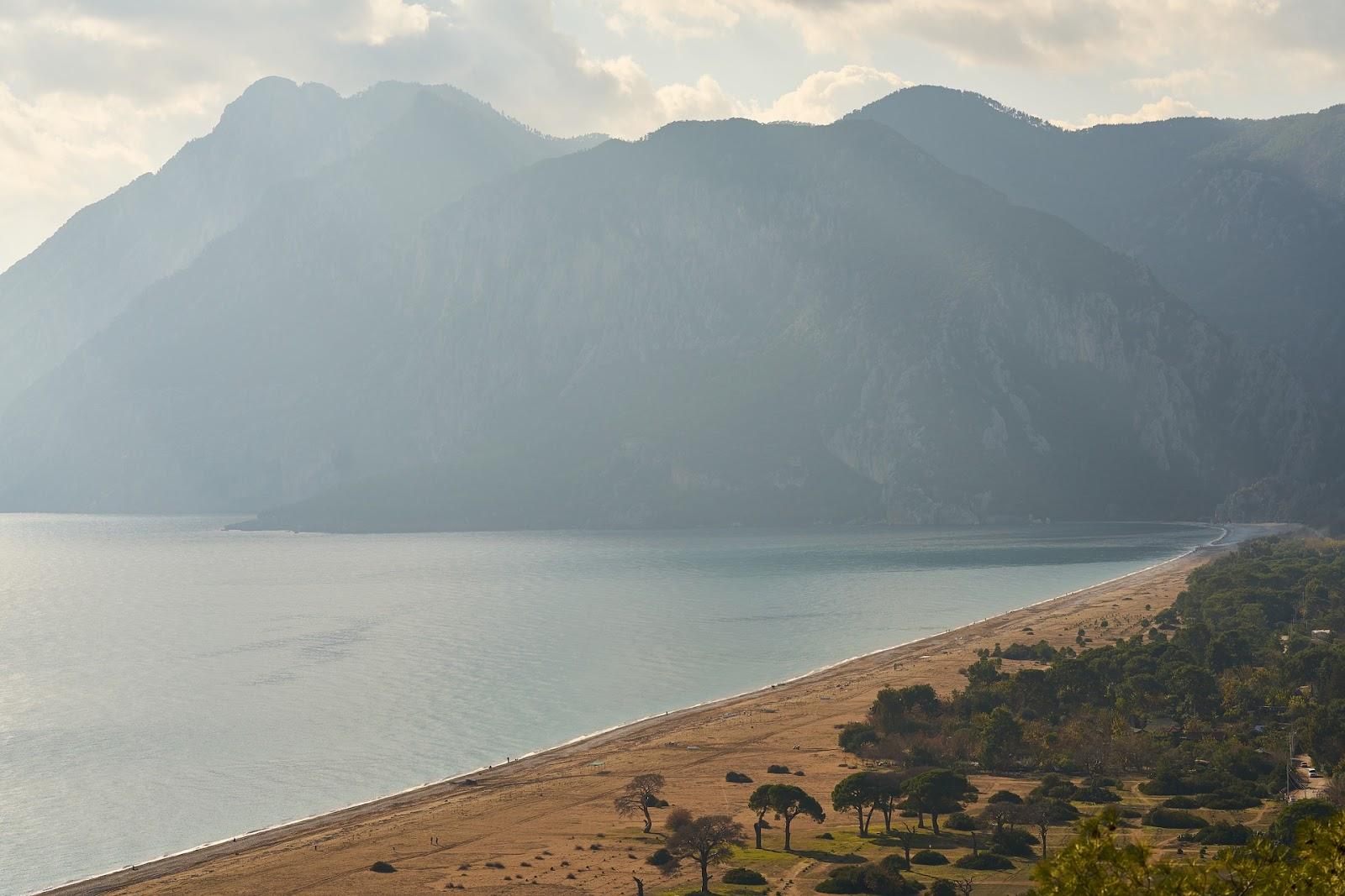 adrasan sandy secluded beach calm sea large mountains turkey riviera