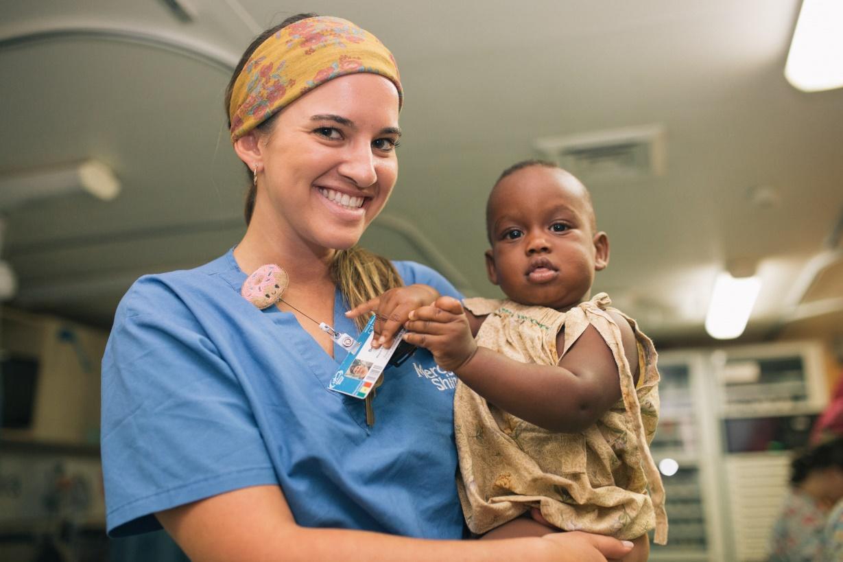 a nurse holding a baby
