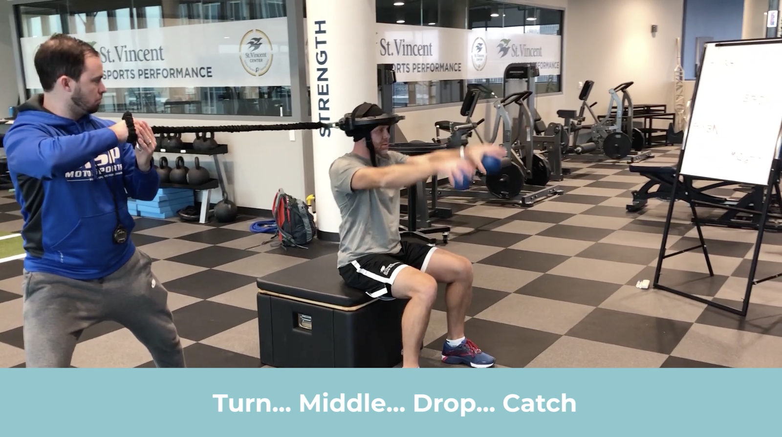 IndyCar driver Ed Carpenter training with Iron Neck at SVSP, doing Seated Iron Neck Memory Recall + Reaction Speed (Medball drop variation)