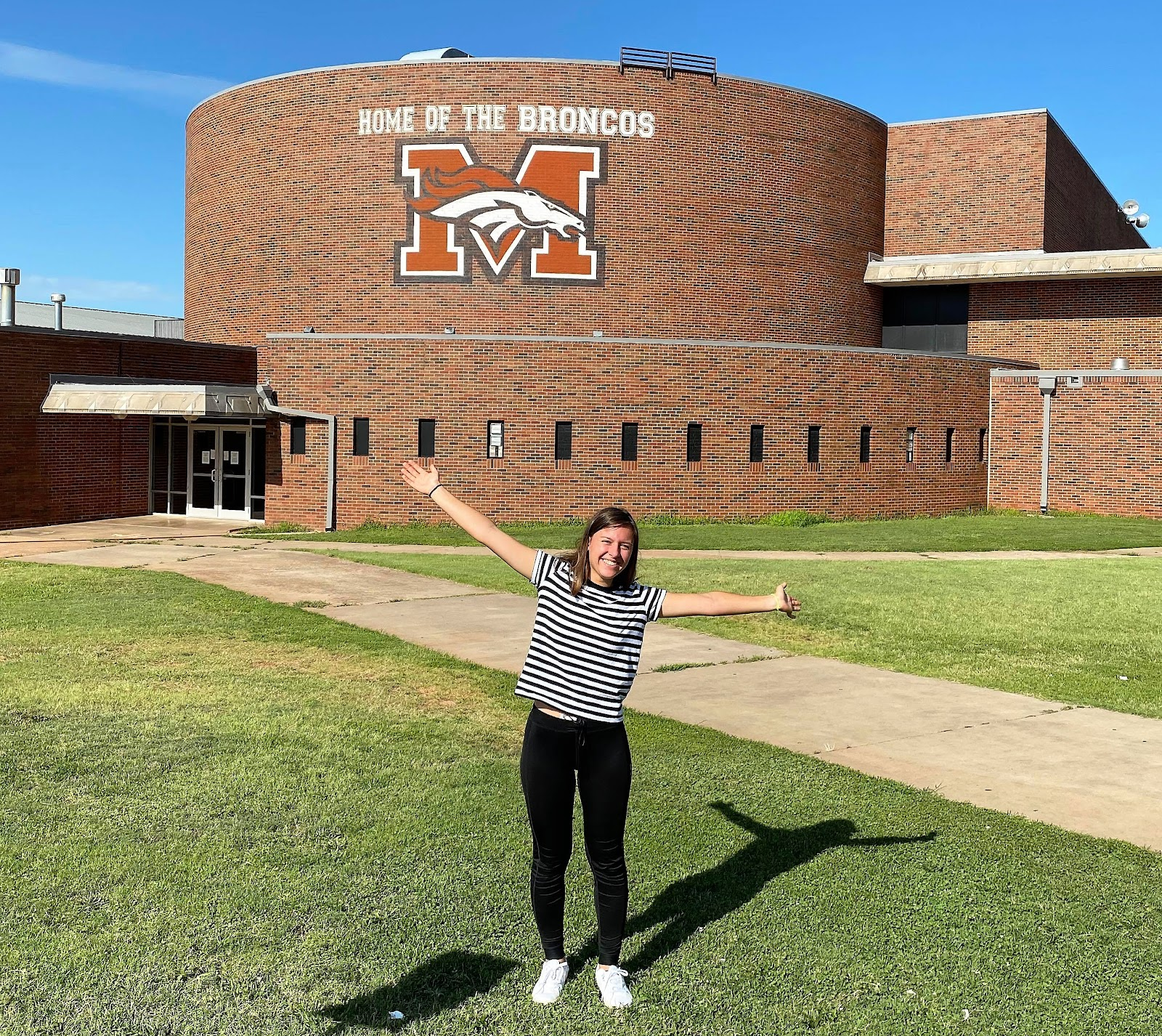 Exchange student in front of high school in USA