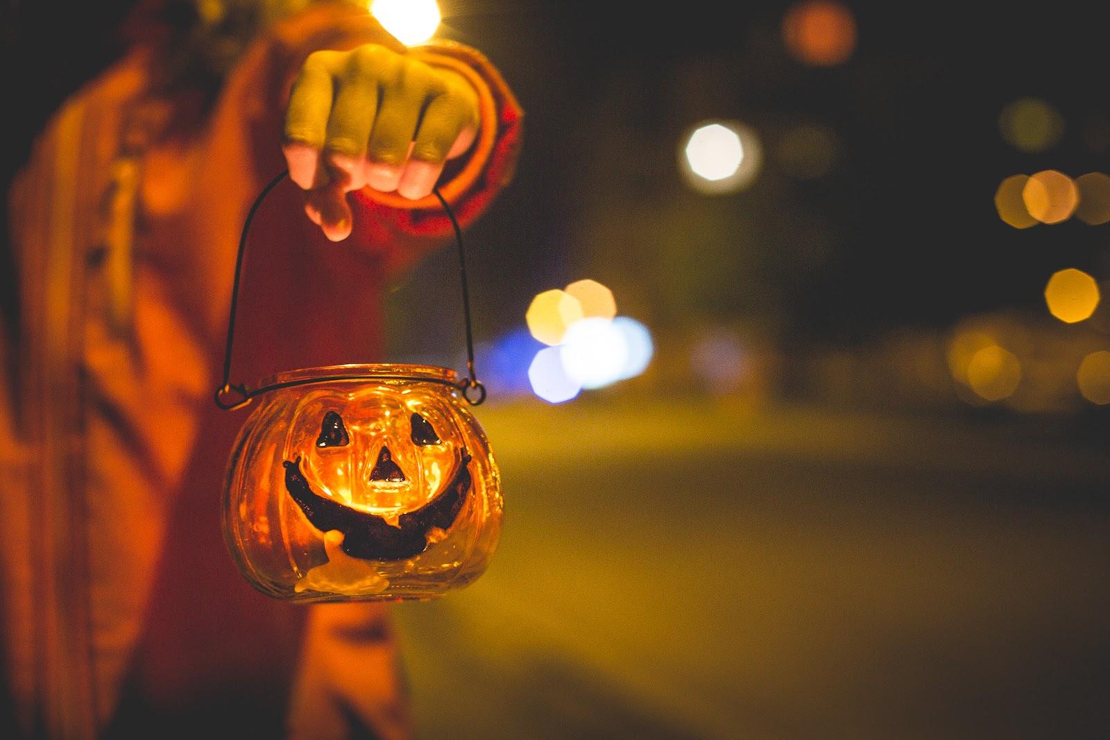 little-girl-holding-halloween-candle-holder-picjumbo-com.jpg