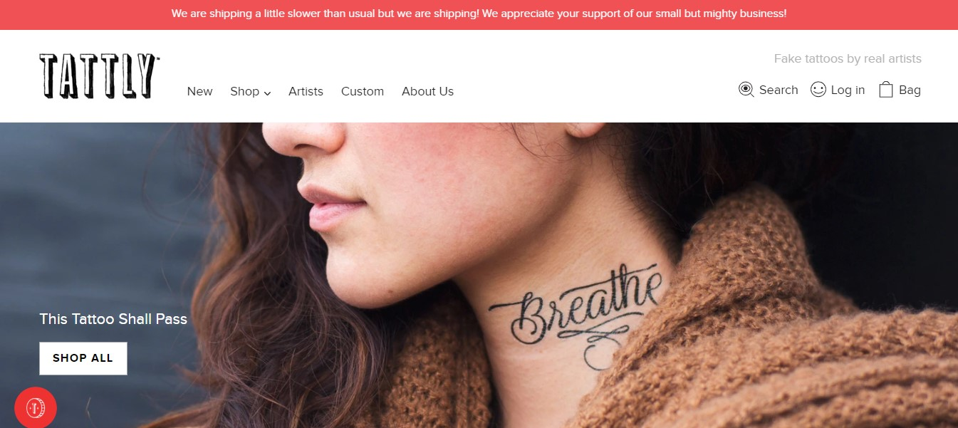 "Tattly's landing page-a woman's neck with a tattoo ""breathe"""