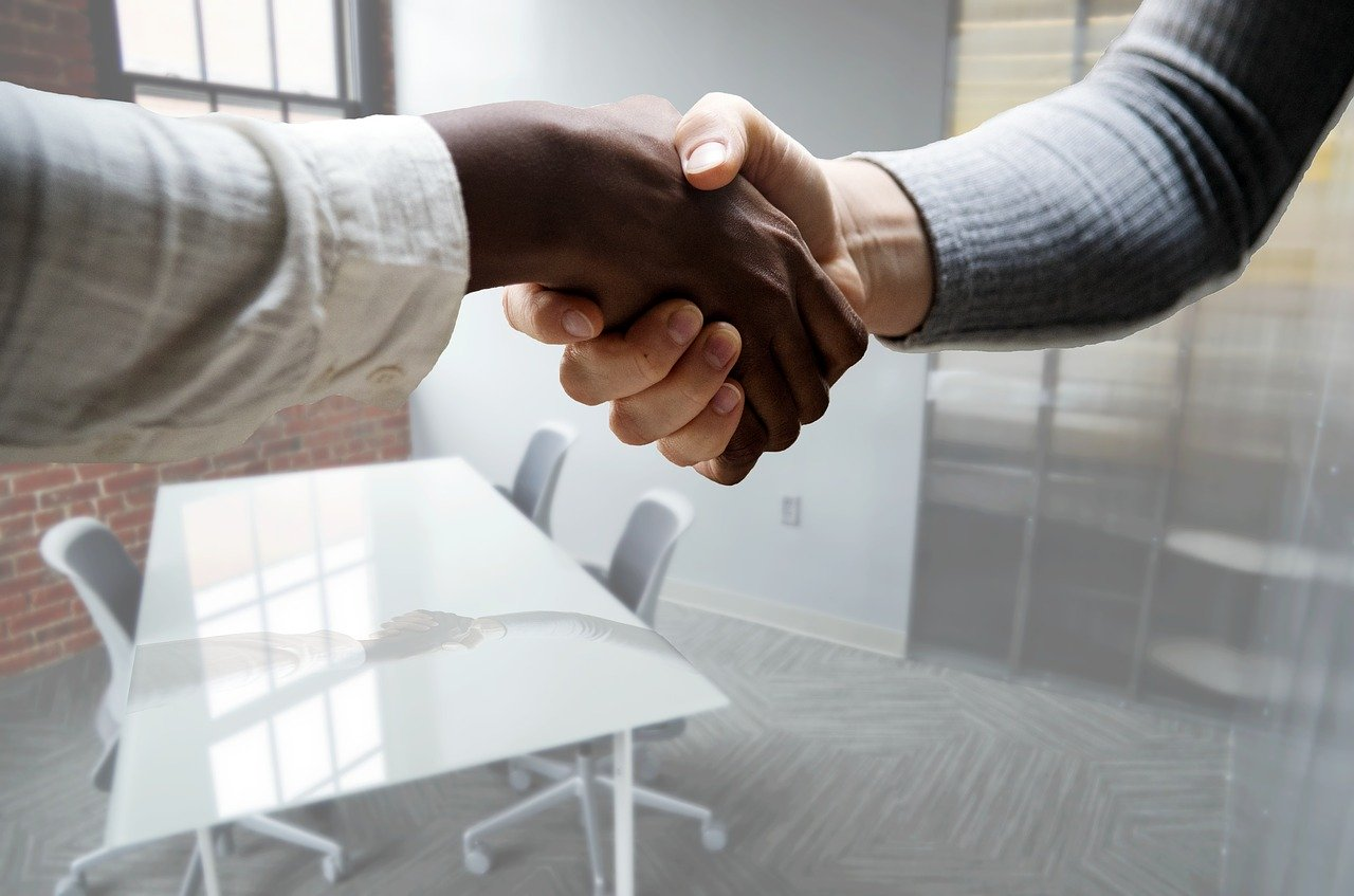 job-interview-hiring-hand-shake-how to transform your career