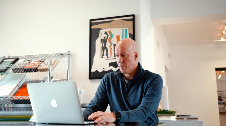 Man at desk using laptop