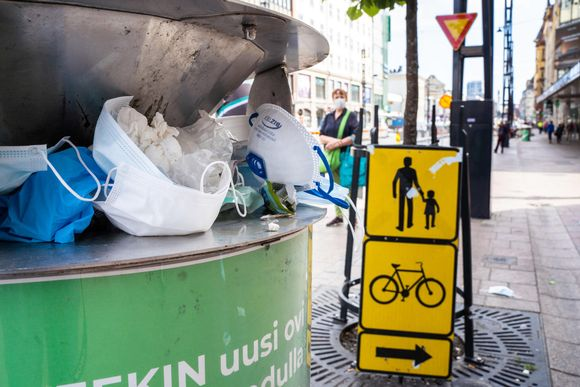 A trash bin overflowing with face masks in Tampere, Finland