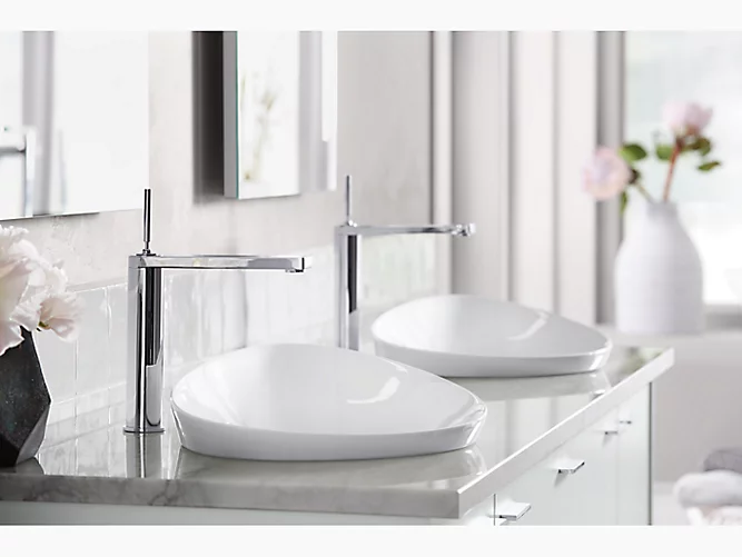 Sleek white bathroom with vessel sinks; sink design styles; Michael Gainey Signature Designs