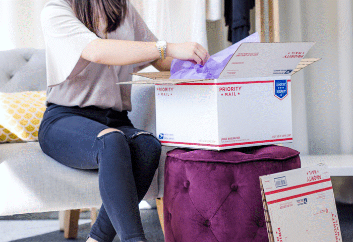 Picture of lady packing shipping packages for selling on poshmark