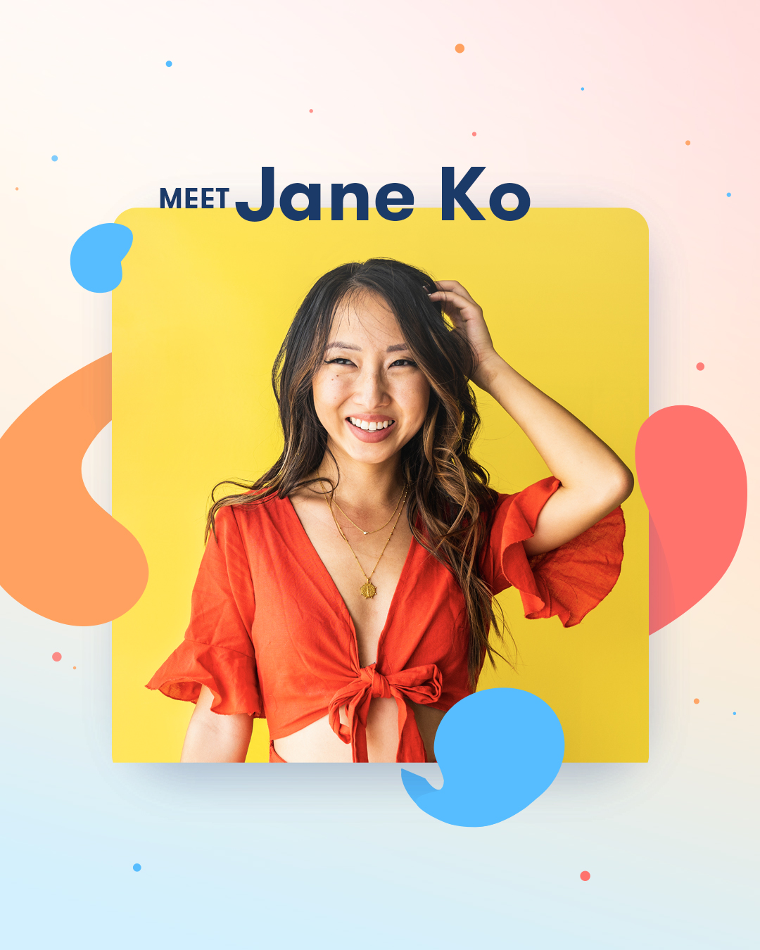 Jane Ko against a bright yellow backdrop, with her left hand in her curled hair. She is wearing a frilled red dress.