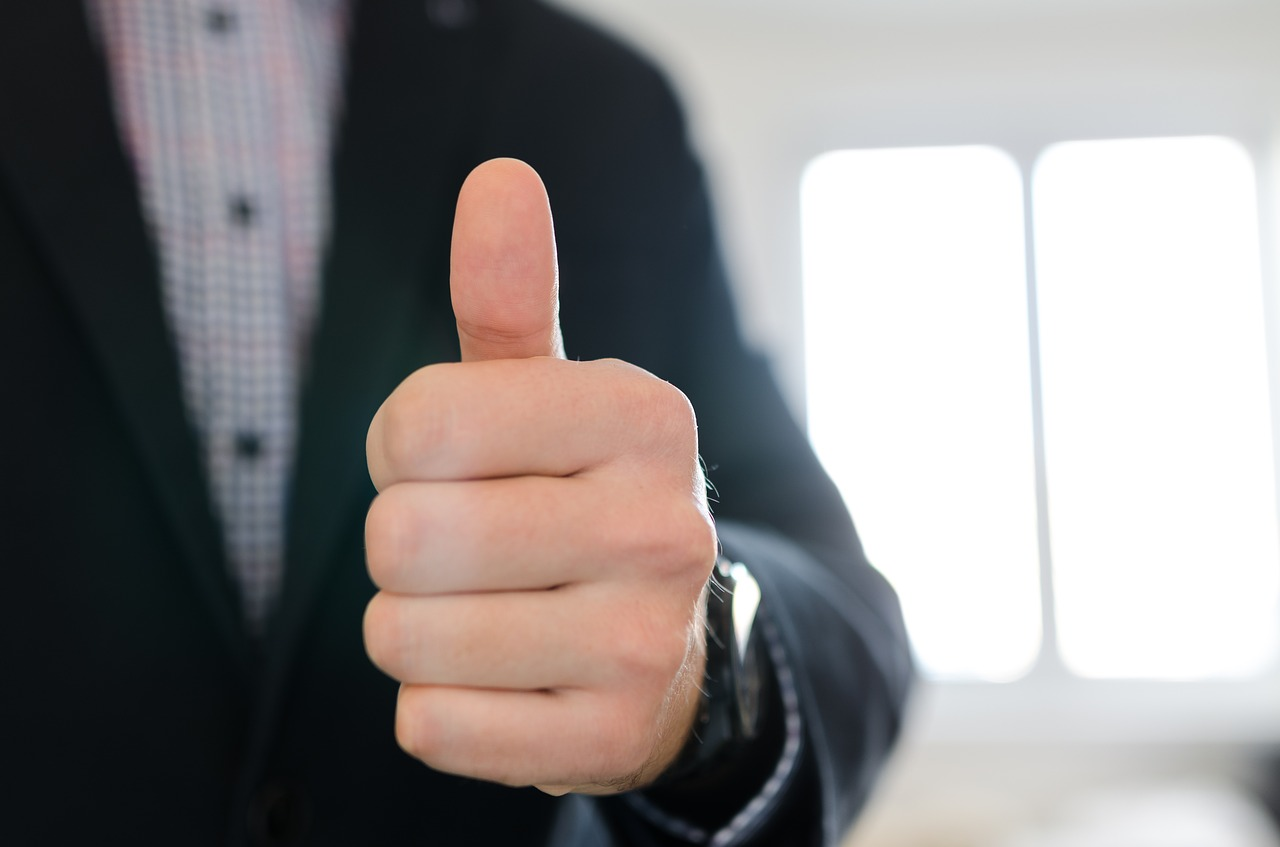 a real estate agent giving a thumbs-up