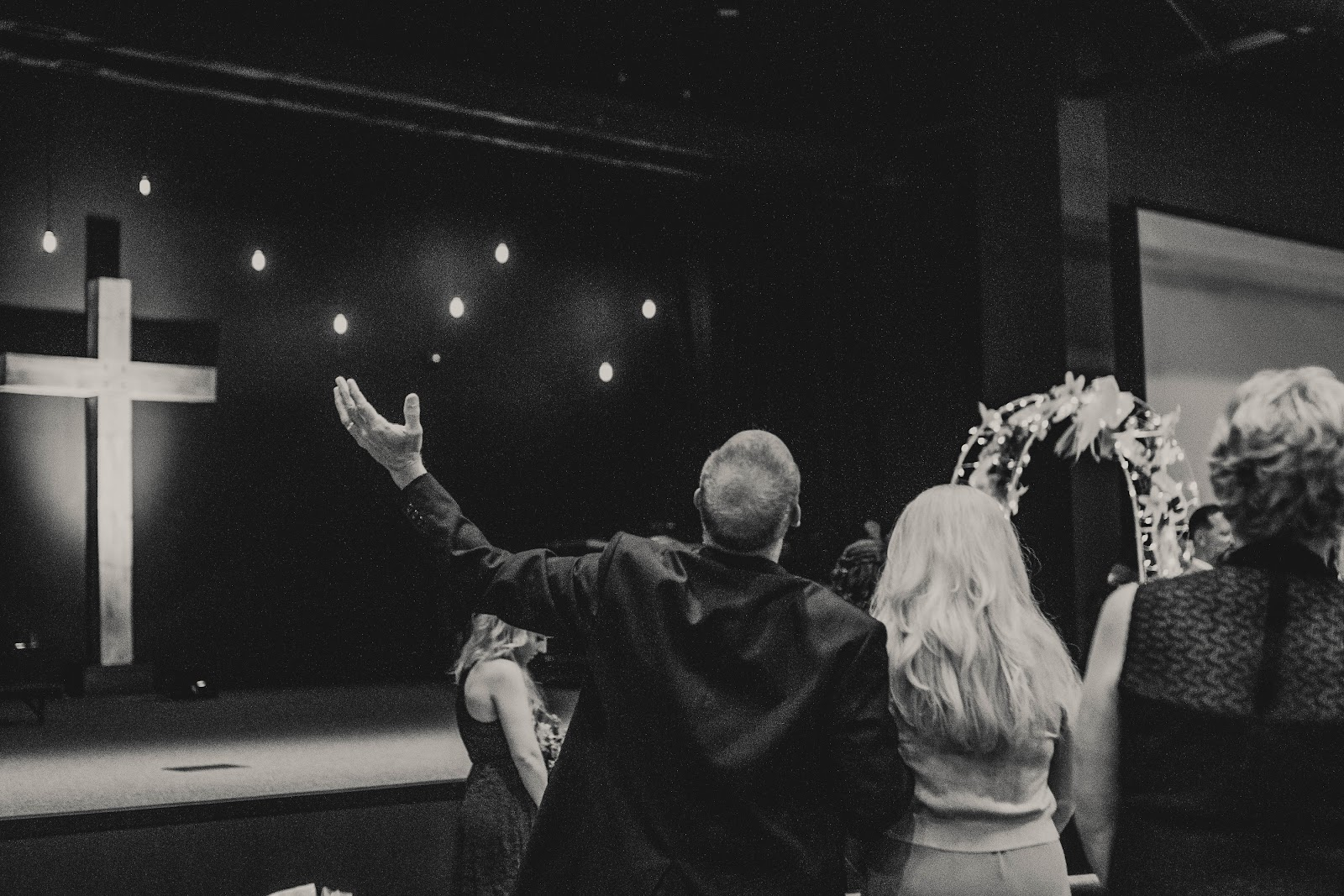 Married couple worshipping in church