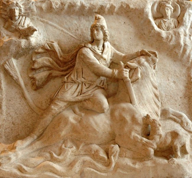 Stone carving of the demigod Mithras stabbing a bull.