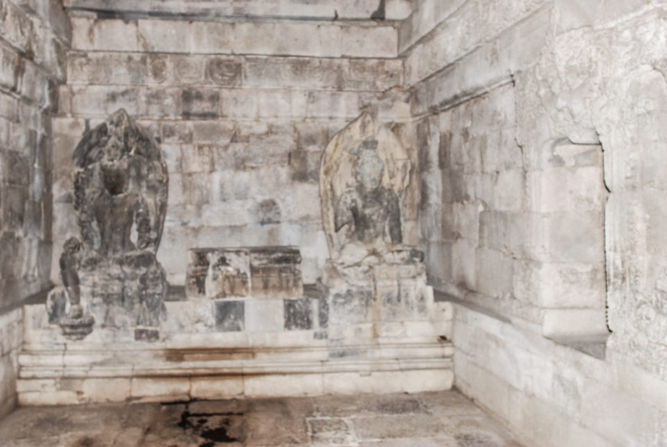 Two Bodhisattva statues with the center one missing in one of the main temples