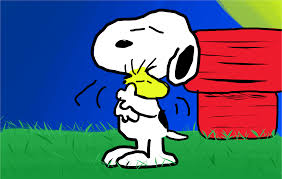Snoopy in front of his doghouse