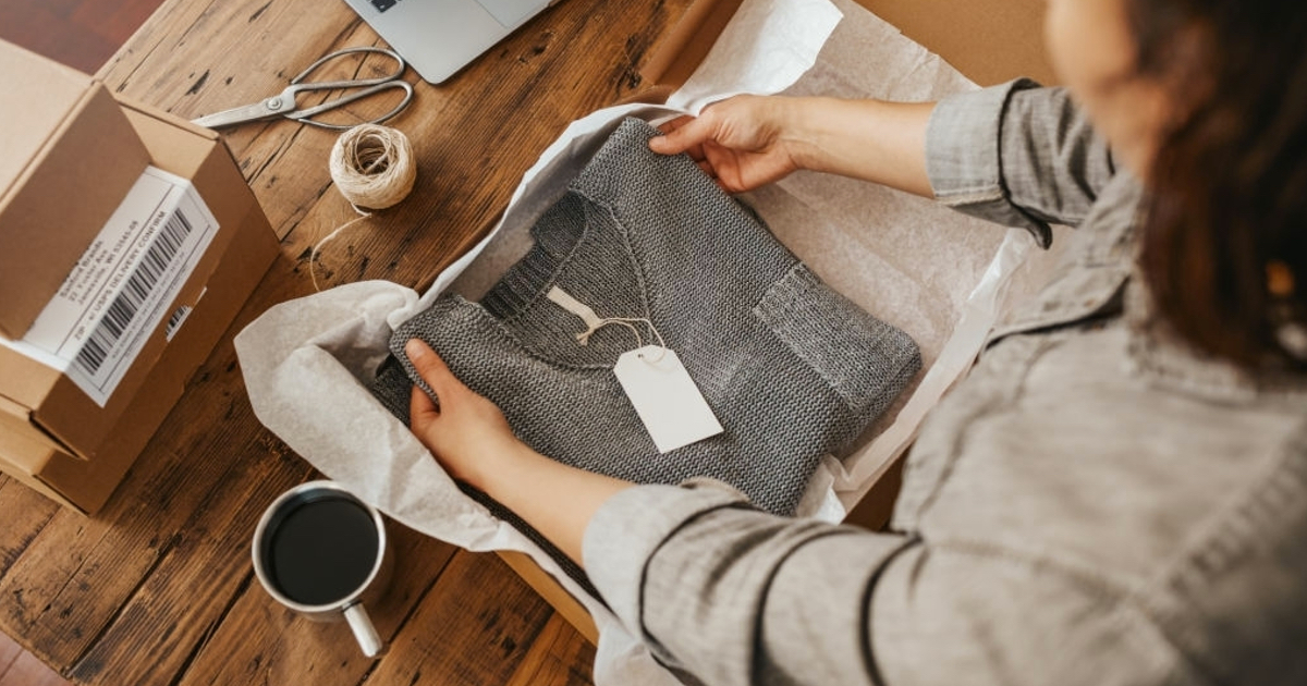 women adding tag to sweater