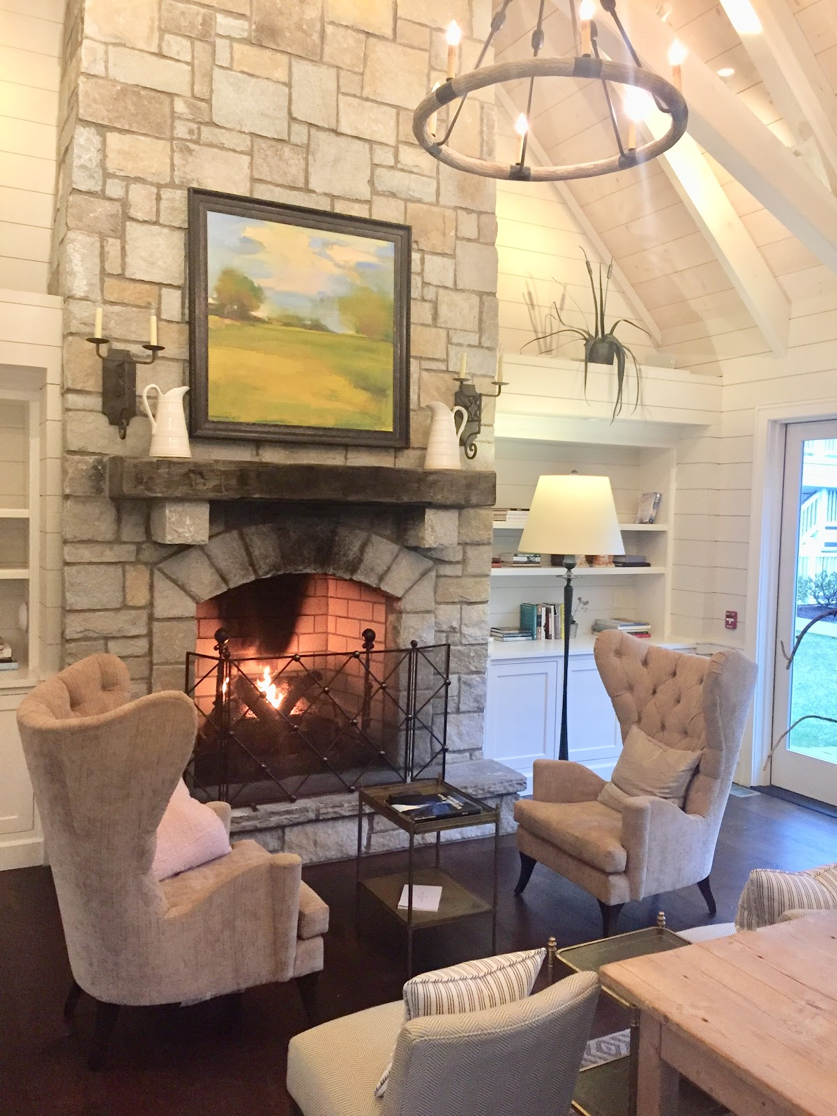 Stone Fireplace Burning With Chandelier