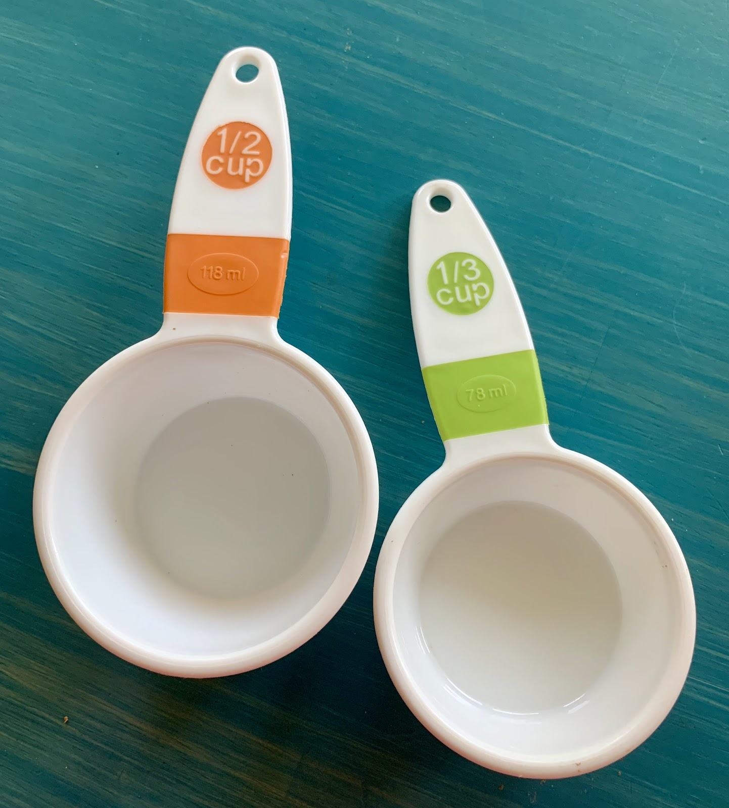 Measuring cups: 1-half cup and 1-third cup.