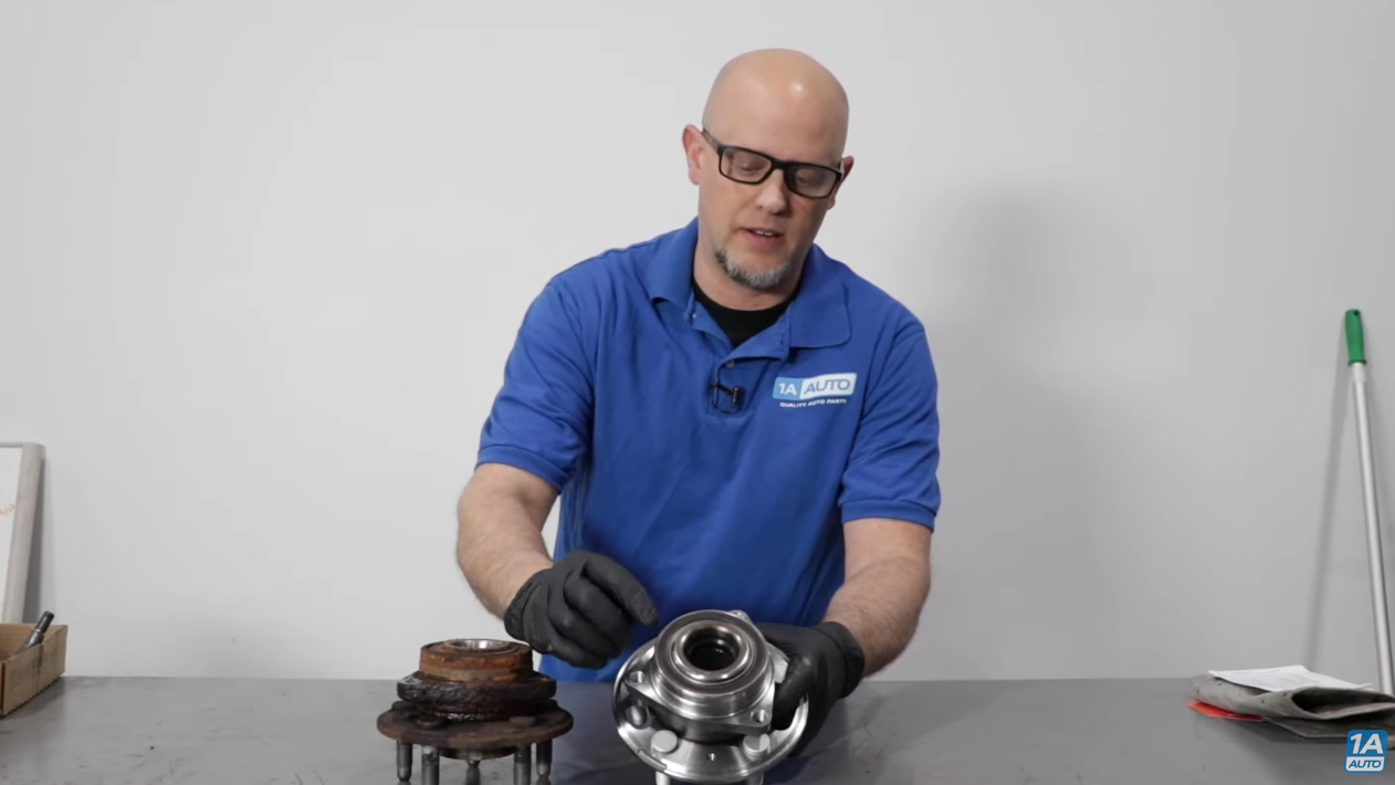 Mechanic holding a wheel hub