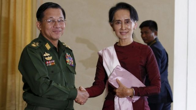 Min Aung Hlaing shakes hands with National League for Democracy (NLD) party leader Aung San Suu Kyi in December 2015