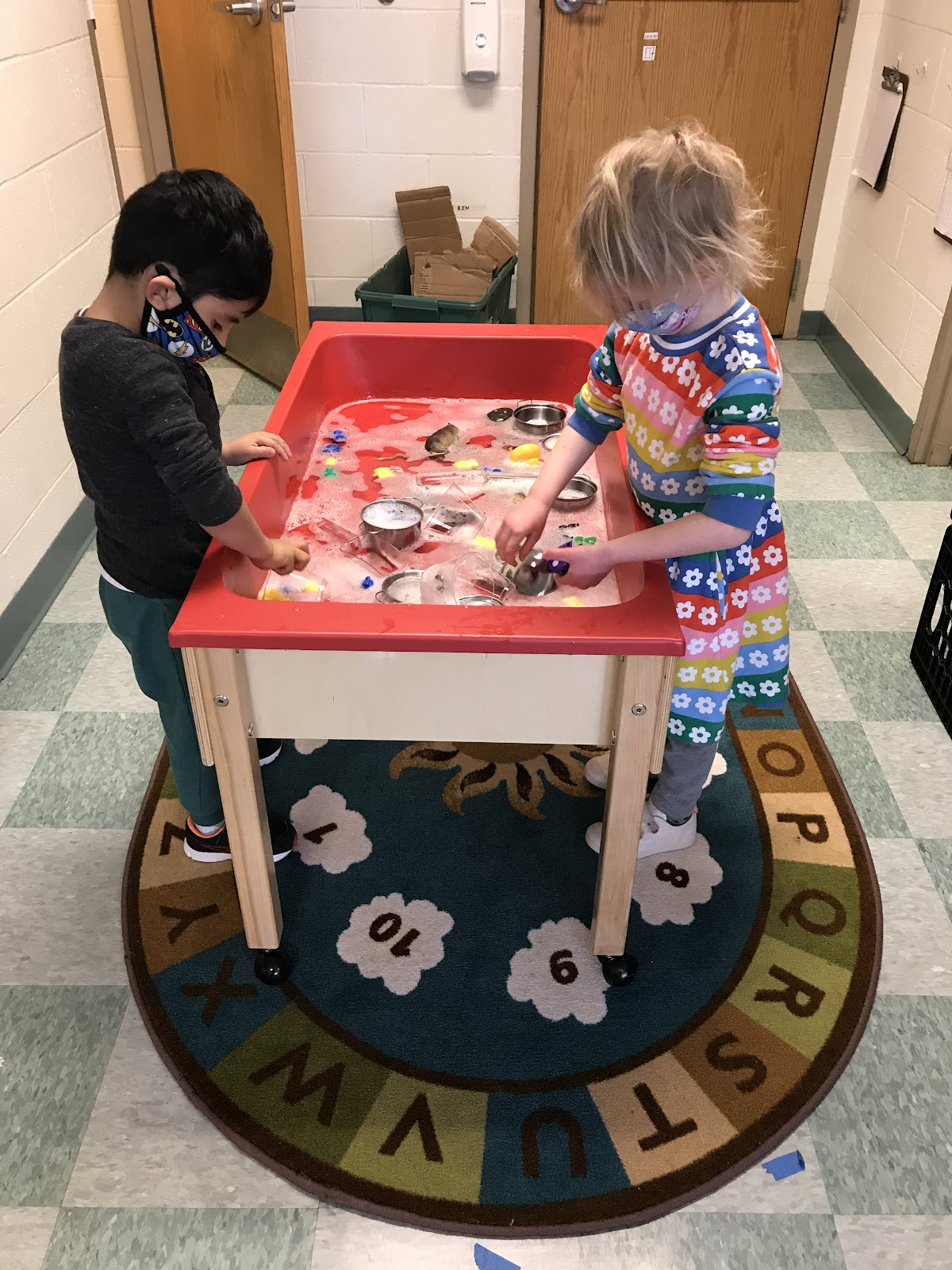 two students at a water table