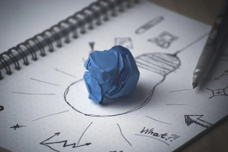 Drawing of light bulb with molding clay in the middle