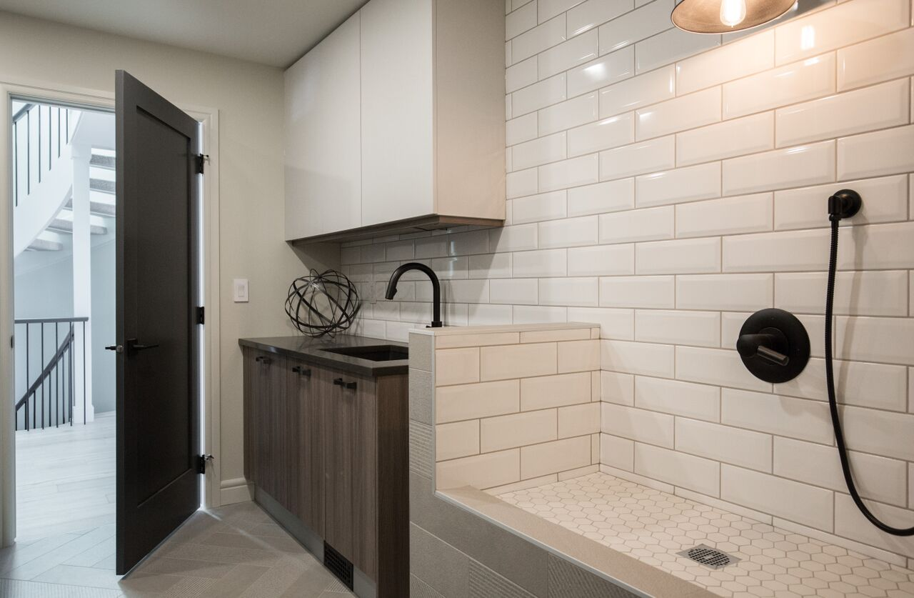 Calgary interior design modern traditional cosy elegant laundry room wash area for pets