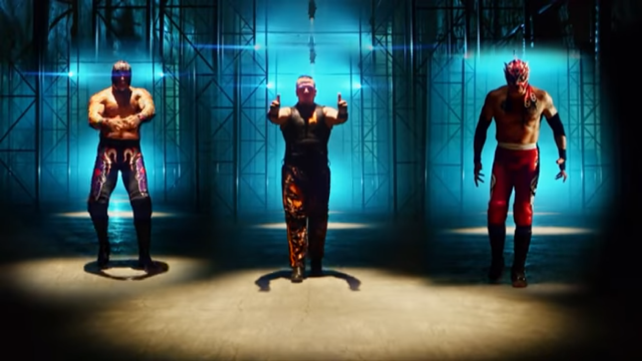 Screen cap from Lucha Underground. Three men (left to right: Mil Muertes, Jeremiah Crane, and Fenix) are standing in a warehouse and approaching the camera menacingly, doing their signature poses/stances.