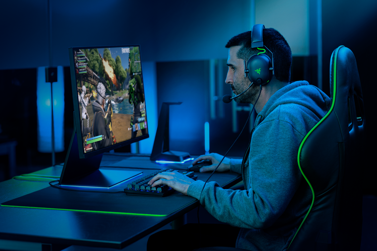 Razer's BlackShark V2 headset with THX Spatial Audio being used by a man to play video games