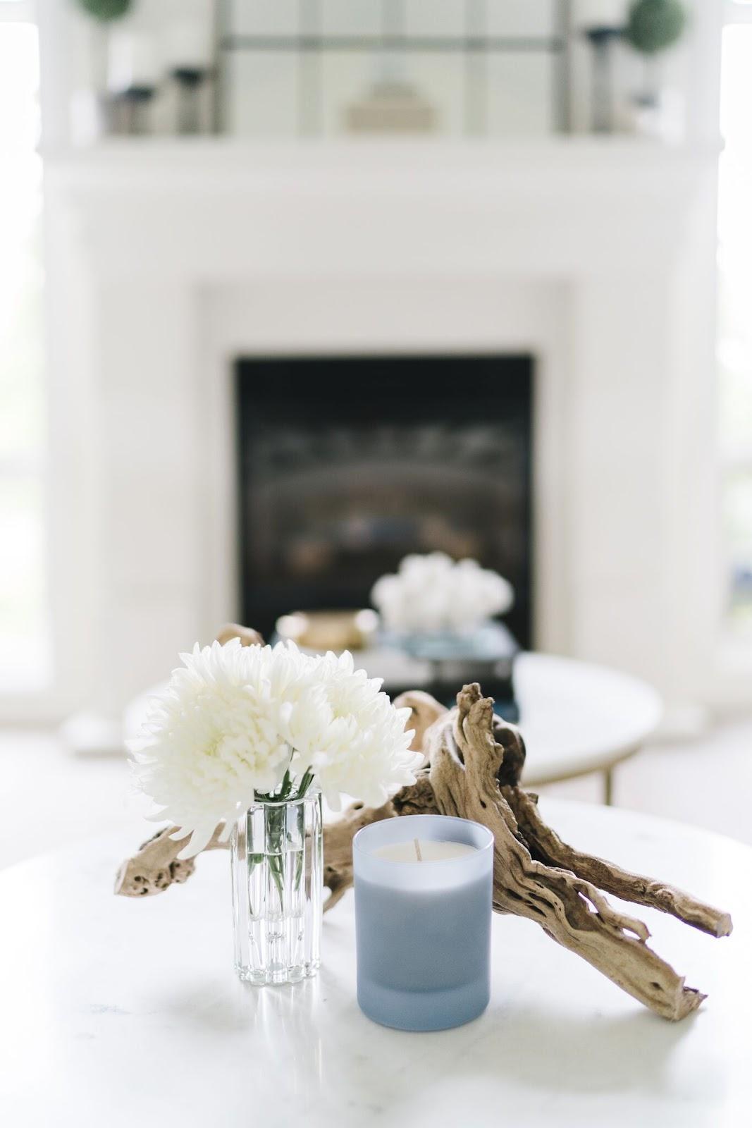 vignette white flowers powder blue candle driftwood calgary interior design living room makeover