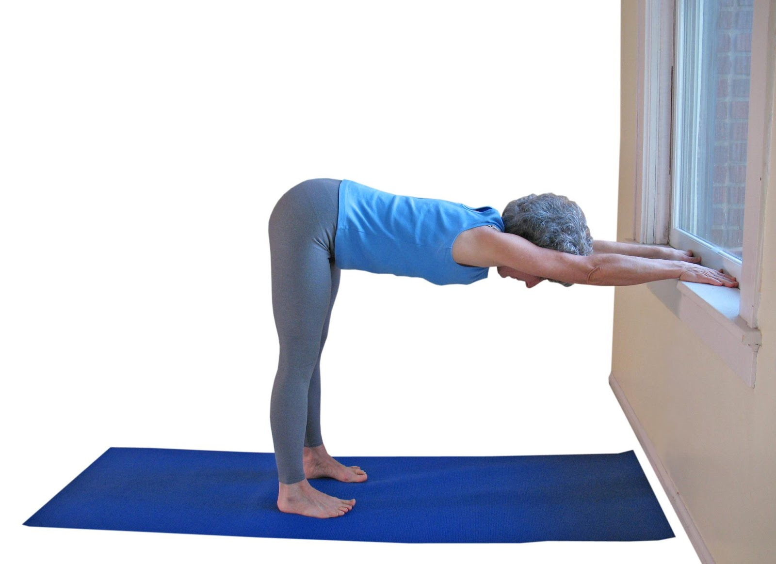 lillah schwartz practicing Downward Dog Prep yoga pose a therapeutic yoga for backpain