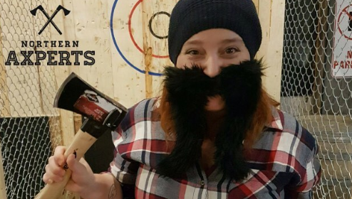 girl wearing fake beard holding ax at Northern Axperts