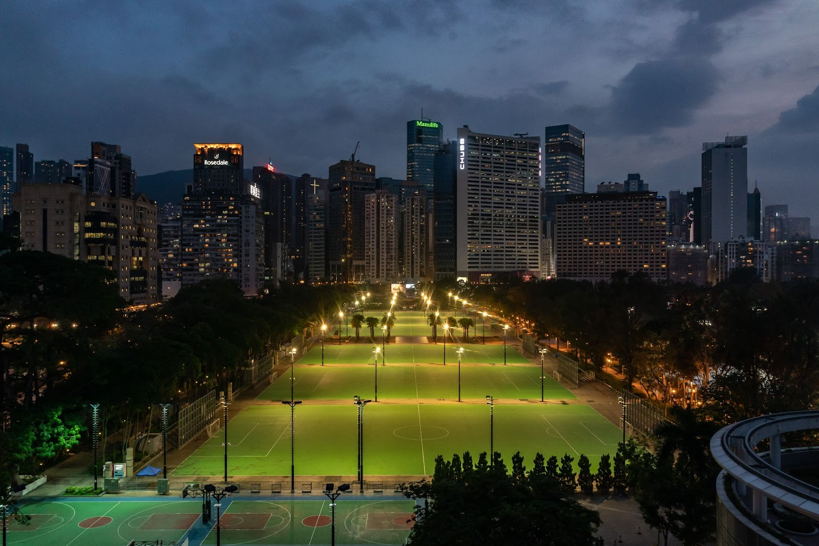 Lights illuminate the closed-off football pitches at Victoria Park, after police closed the venue where Hong Kong people traditionally gather annually to mourn the victims of China's Tiananmen Square massacre in 1989, in the Causeway Bay district on June 4, 2021 in Hong Kong. The authorities have banned the gathering as they cite the coronavirus pandemic as an excuse, vowing to stamp out any protests on the anniversary.