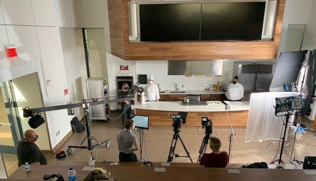 A view of chefs and a video production team in the Wasserstrom Family Foundation Culinary Theater in Mitchell Hall, Columbus State Community College.