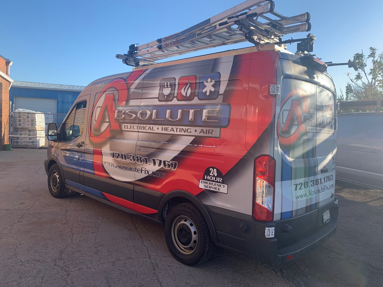 red, white, and blue Absolute-branded company vehicle