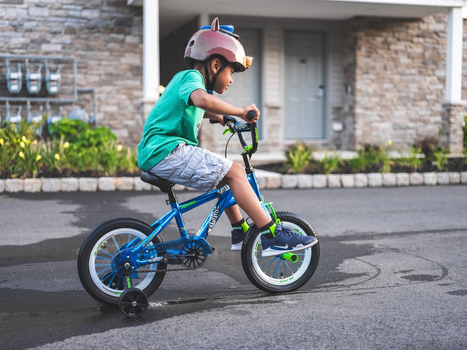 young boy riding bicycle street shelter in place home organization bikes