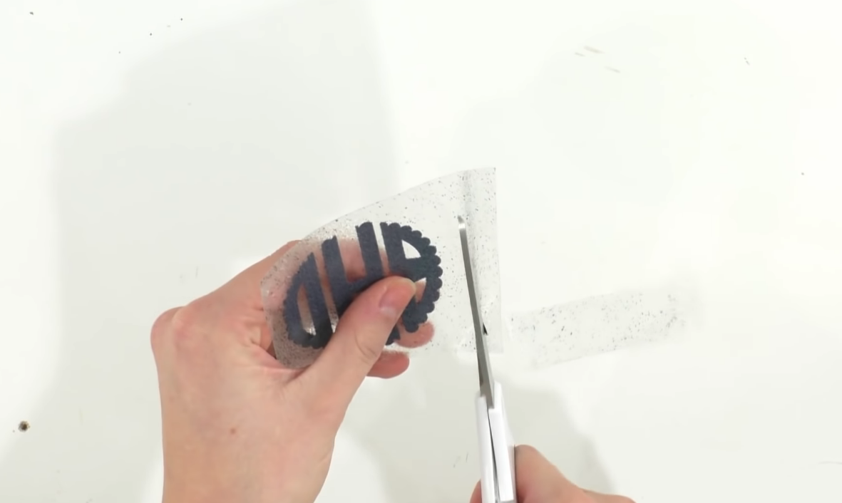 trim away excess transfer tape